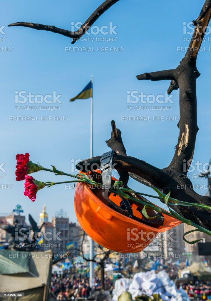 Helmet Flower Maidan Kiev stock photo