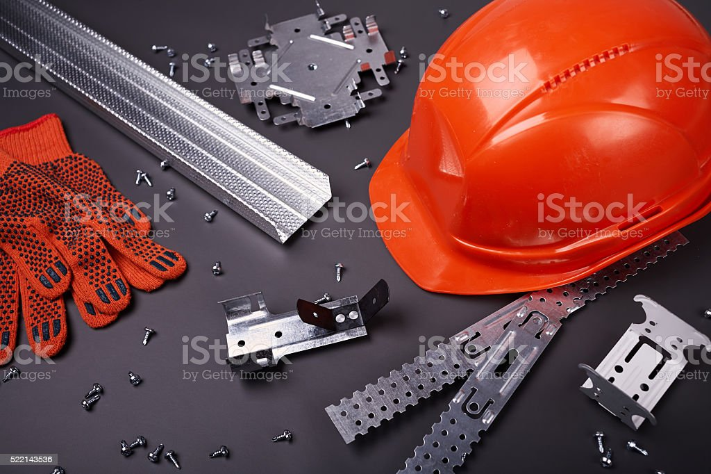 Helmet, gloves and fasteners stock photo