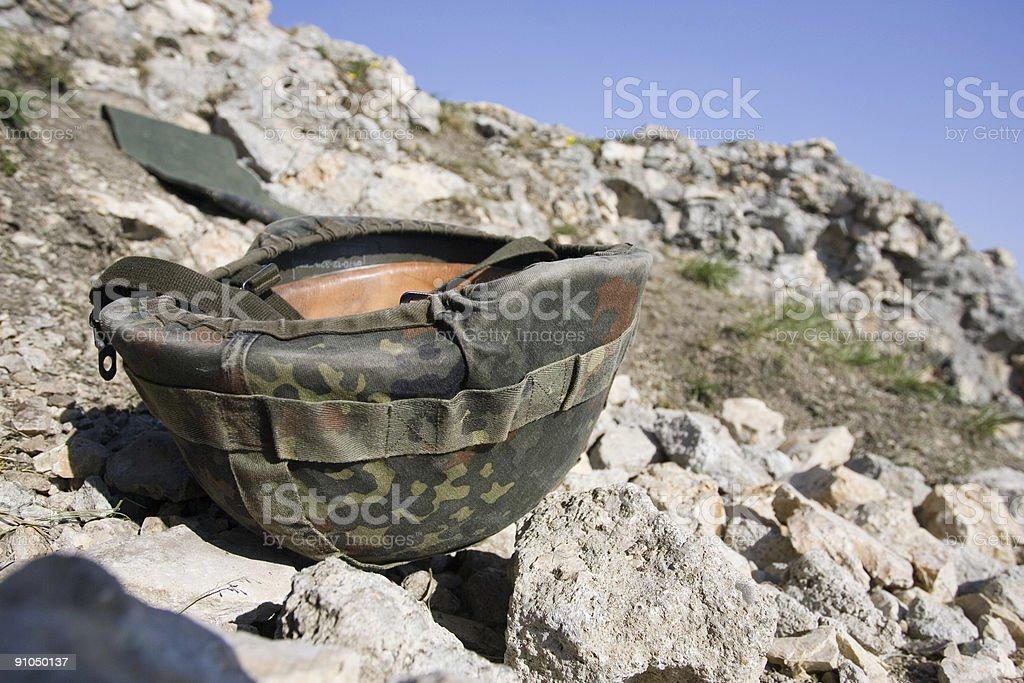 Helmet in the mountains stock photo