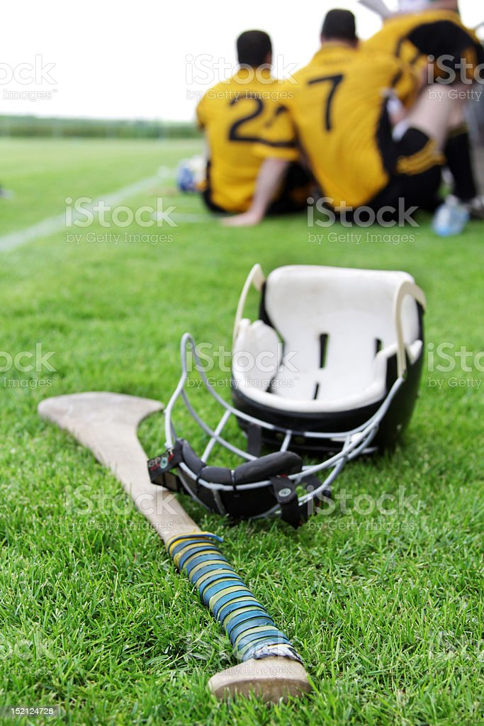 Helmet lying after hurling match stock photo
