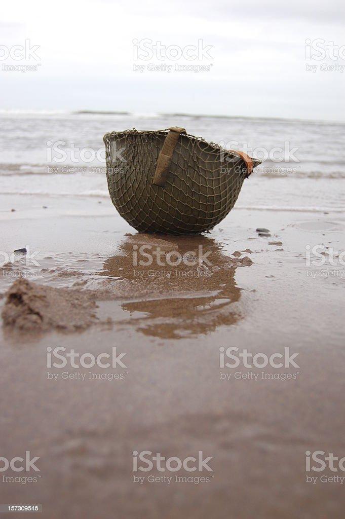 Helmet on Omaha Beach. stock photo