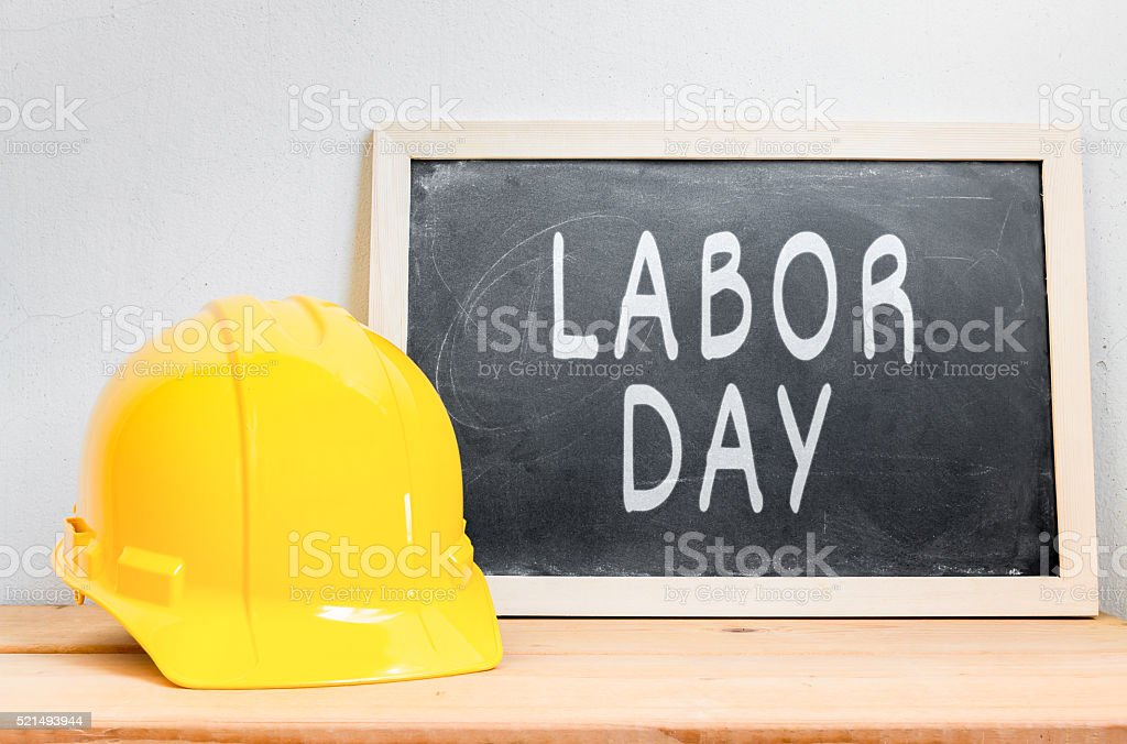 Helmet safety with chalkboard on wood table stock photo