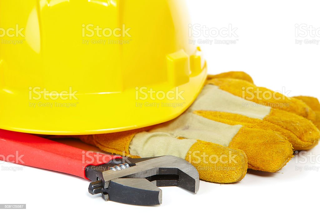 Helmet, spanner and coarse leather gloves royalty-free stock photo