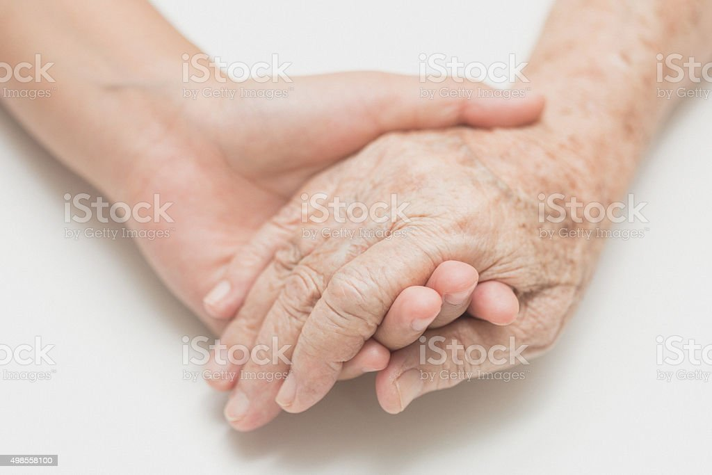 Help concept,The helping hands for elderly home care stock photo