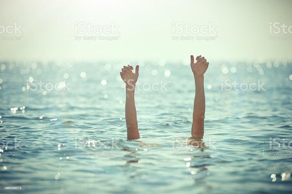 help, i'm drowning stock photo