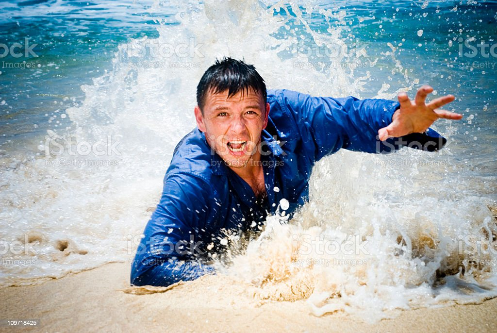 Help! Man reaching up from the shoreline. royalty-free stock photo