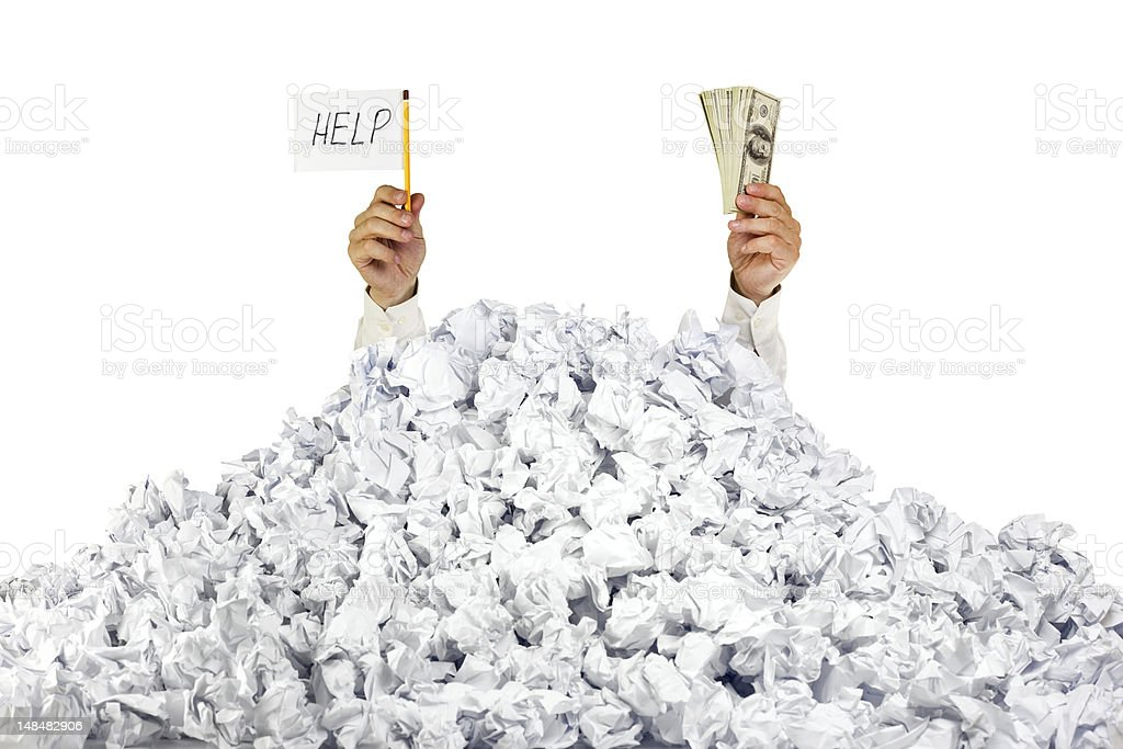 Help me! Person under crumpled pile of papers stock photo