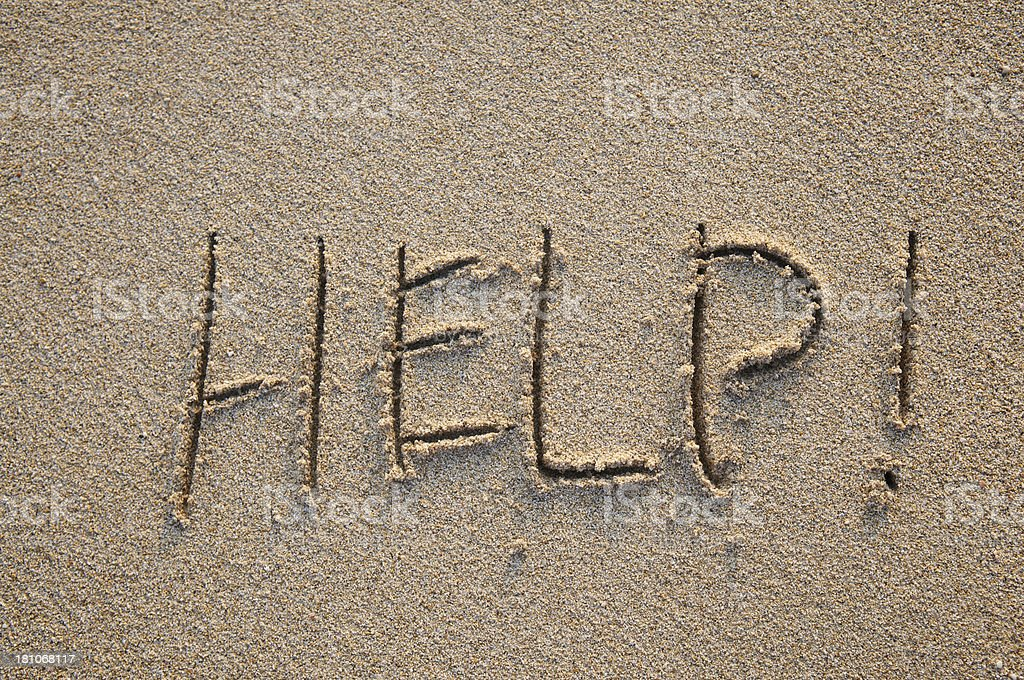 Help! Message Written in Textured Sand royalty-free stock photo