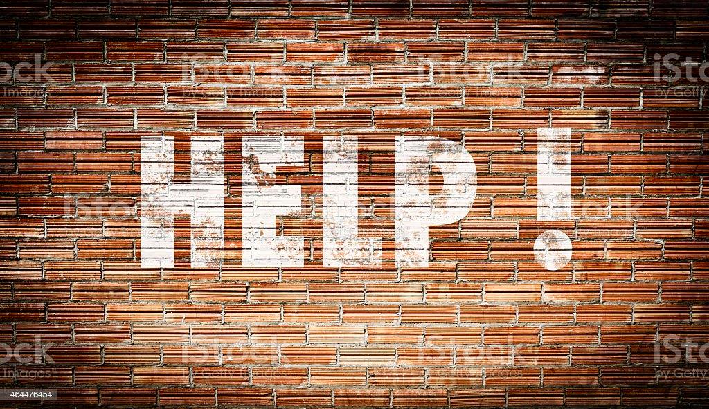Help on brick wall stock photo