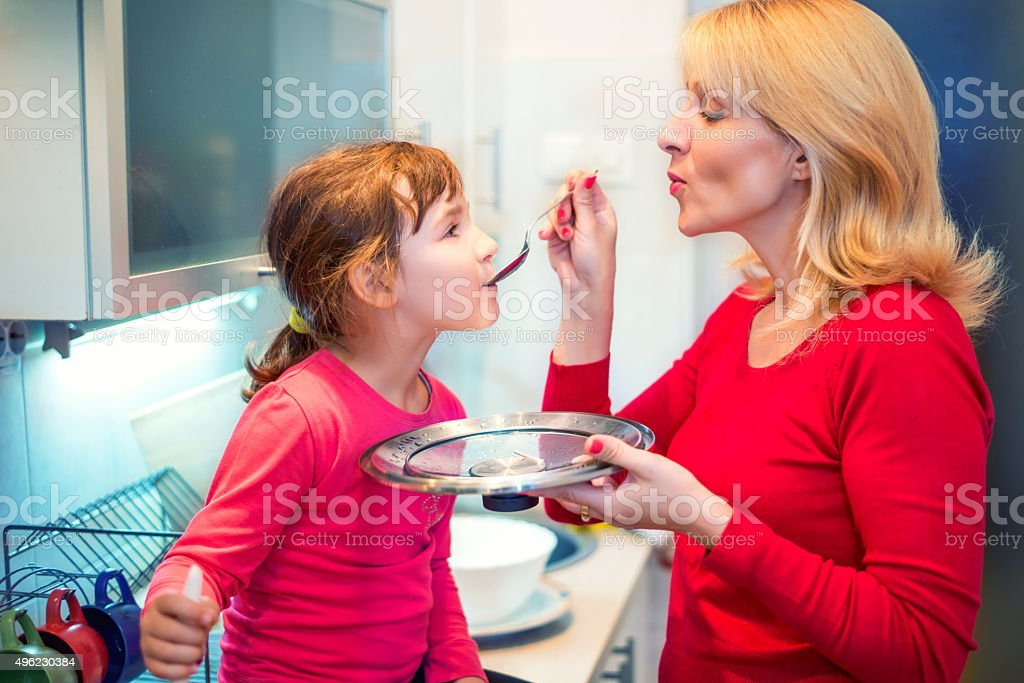 Help to mother in kitchen stock photo