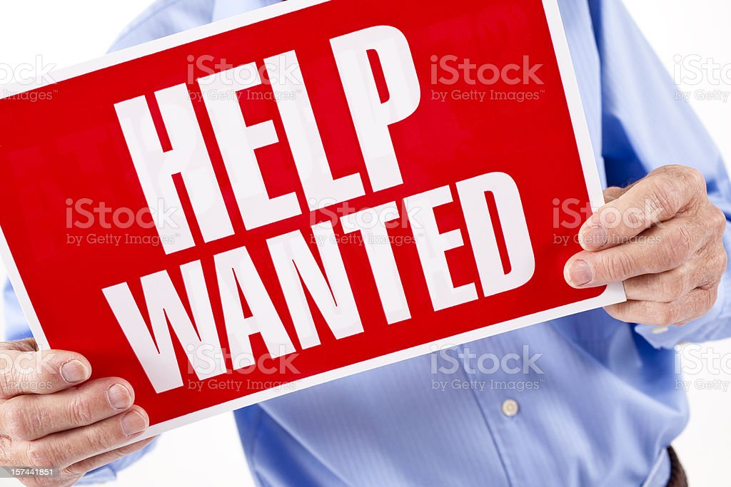 Help Wanted sign. Adult man business owner. Employment. Hiring. royalty-free stock photo