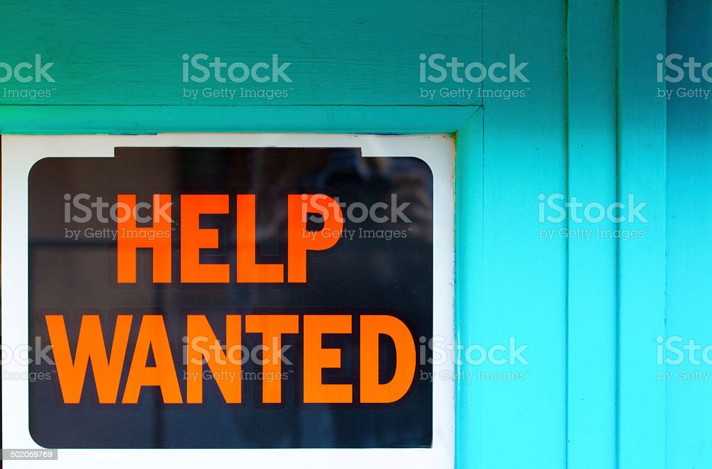 Help Wanted Sign in Old Blue Window stock photo