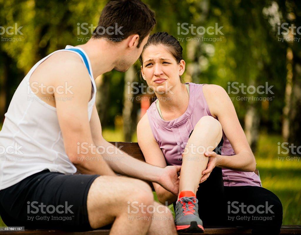 Help - woman with leg injury royalty-free stock photo