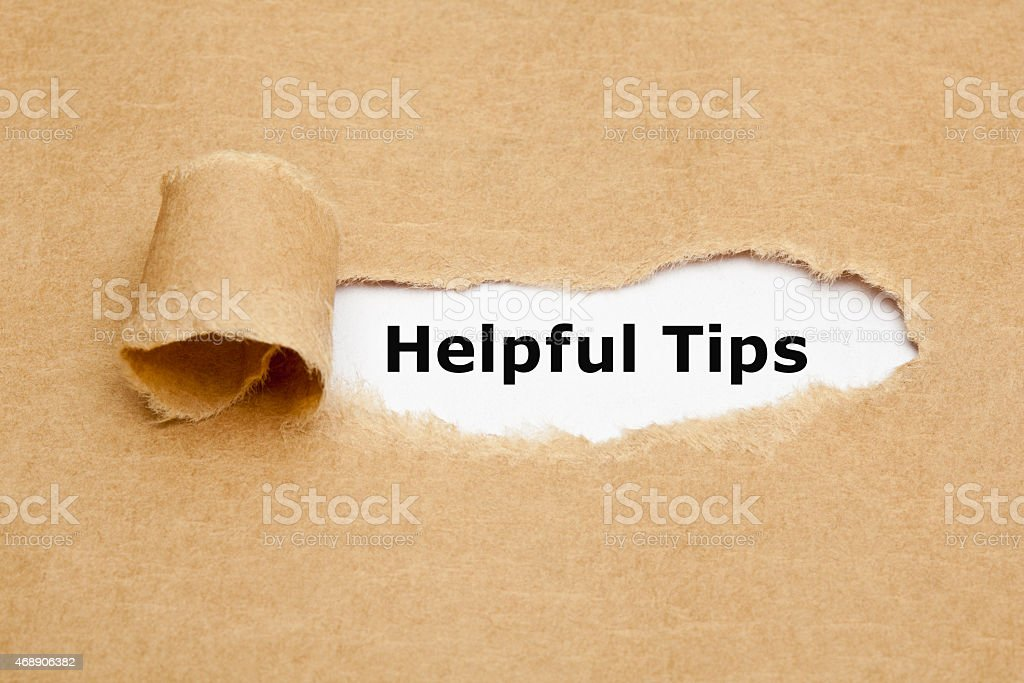 Helpful Tips Torn Paper stock photo