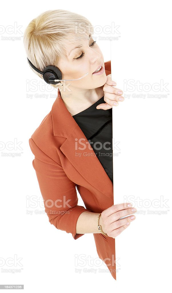Helpful Woman with Headset Peeks Around Edge royalty-free stock photo