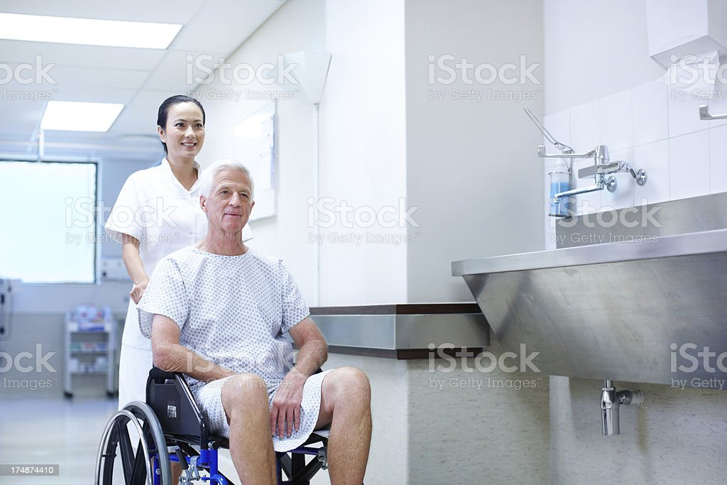 Helping a patient royalty-free stock photo