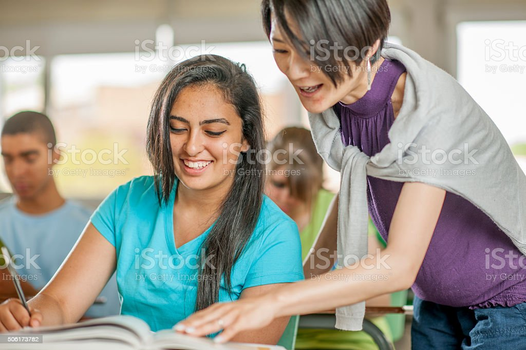 Helping a Student with a Question stock photo