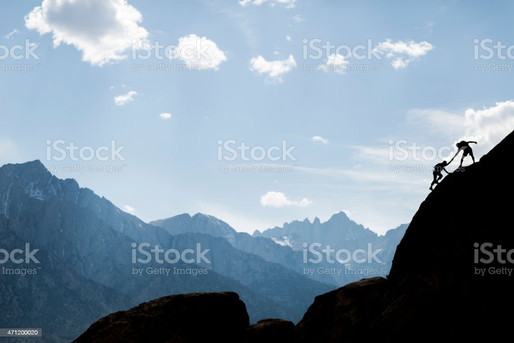 helping climbers stock photo