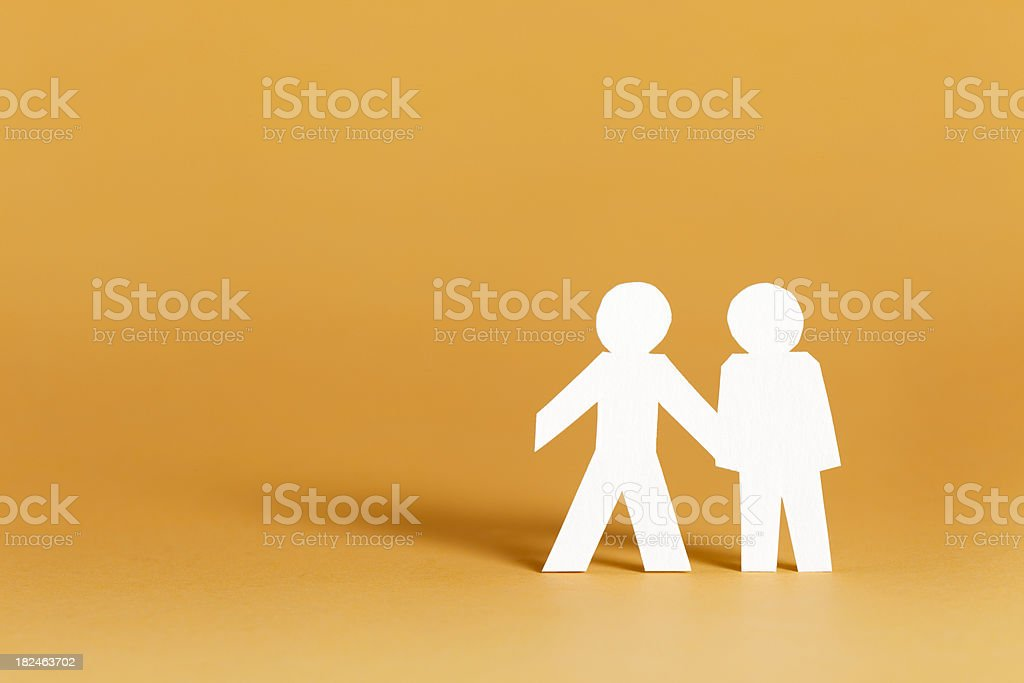 Helping concept with paper cutouts stock photo