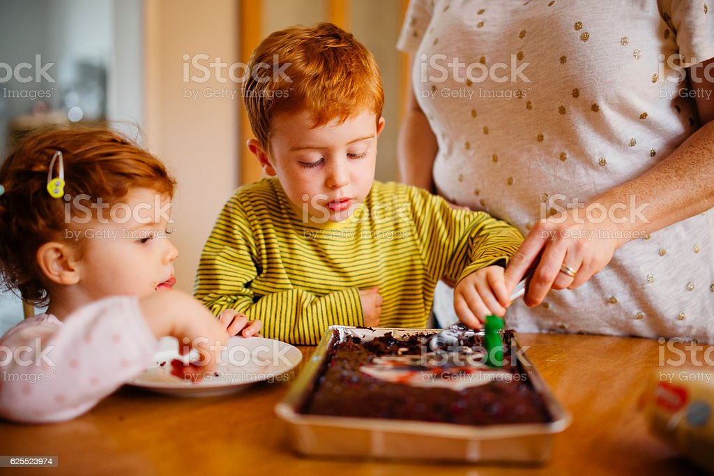Helping Cut the Cake stock photo