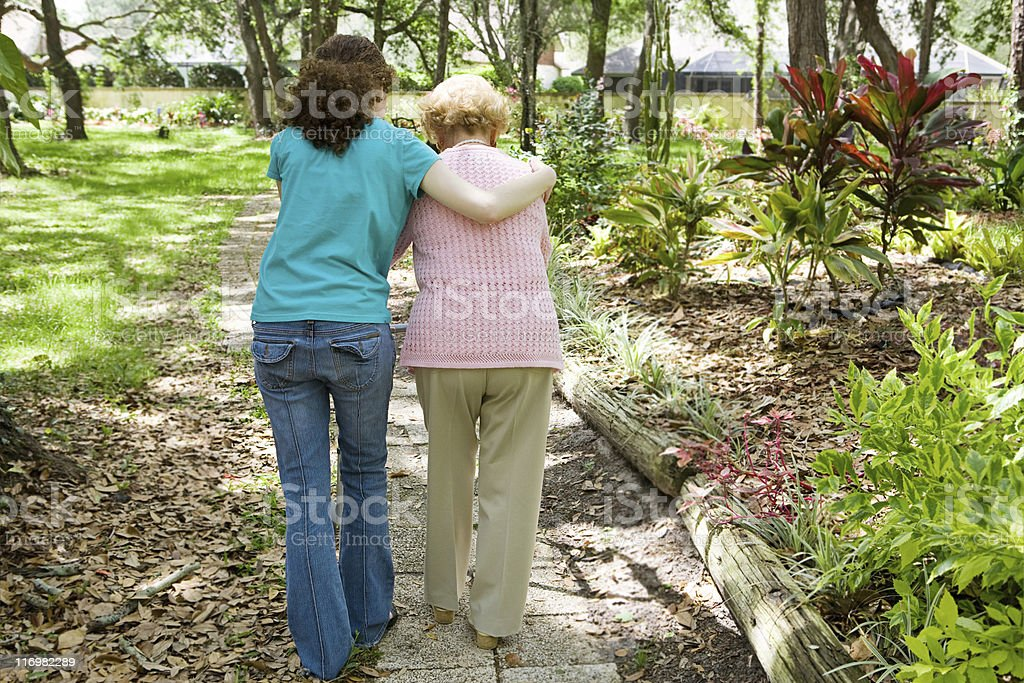 Helping Grandmother Walk stock photo