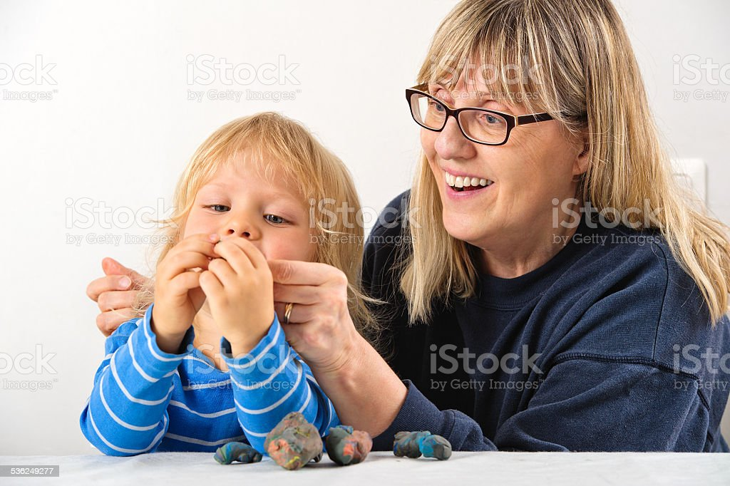 helping grandson to play stock photo