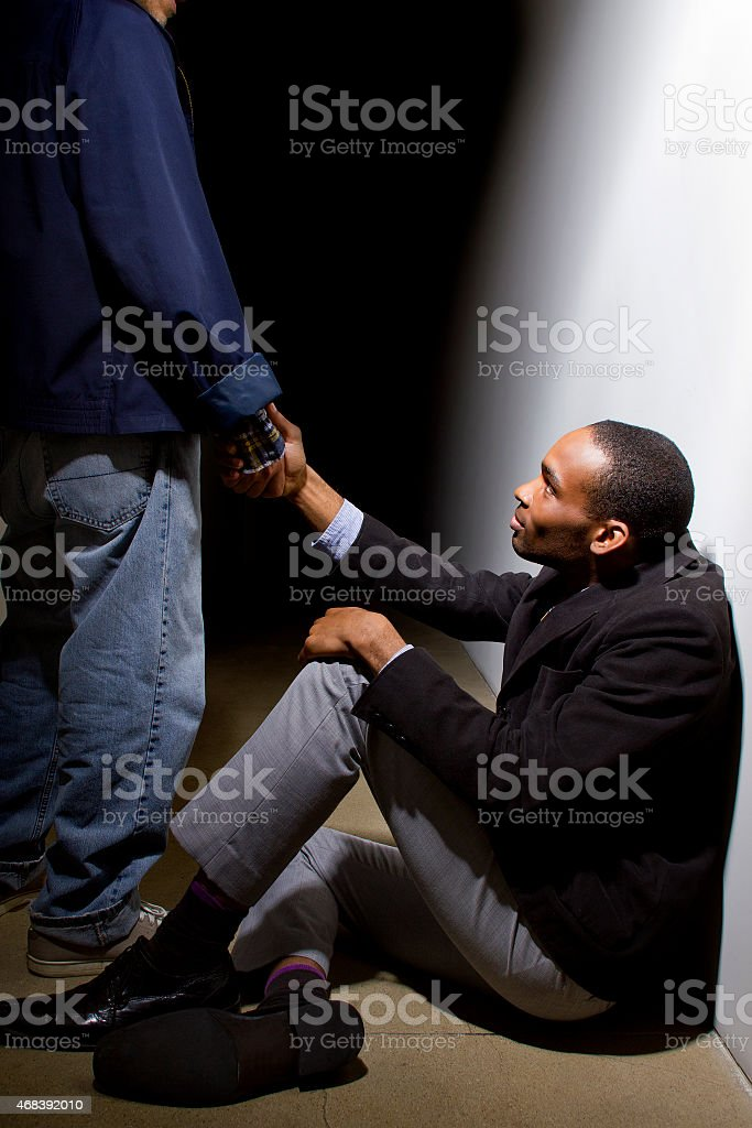 Helping Hand and Good Deeds Given to a Black Man stock photo