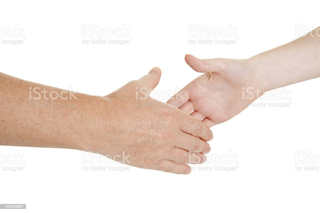 Helping hand: caring comforting adult hand reaching for chilld's royalty-free stock photo