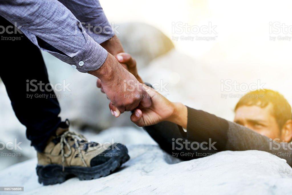 Helping Hand On Mountain stock photo