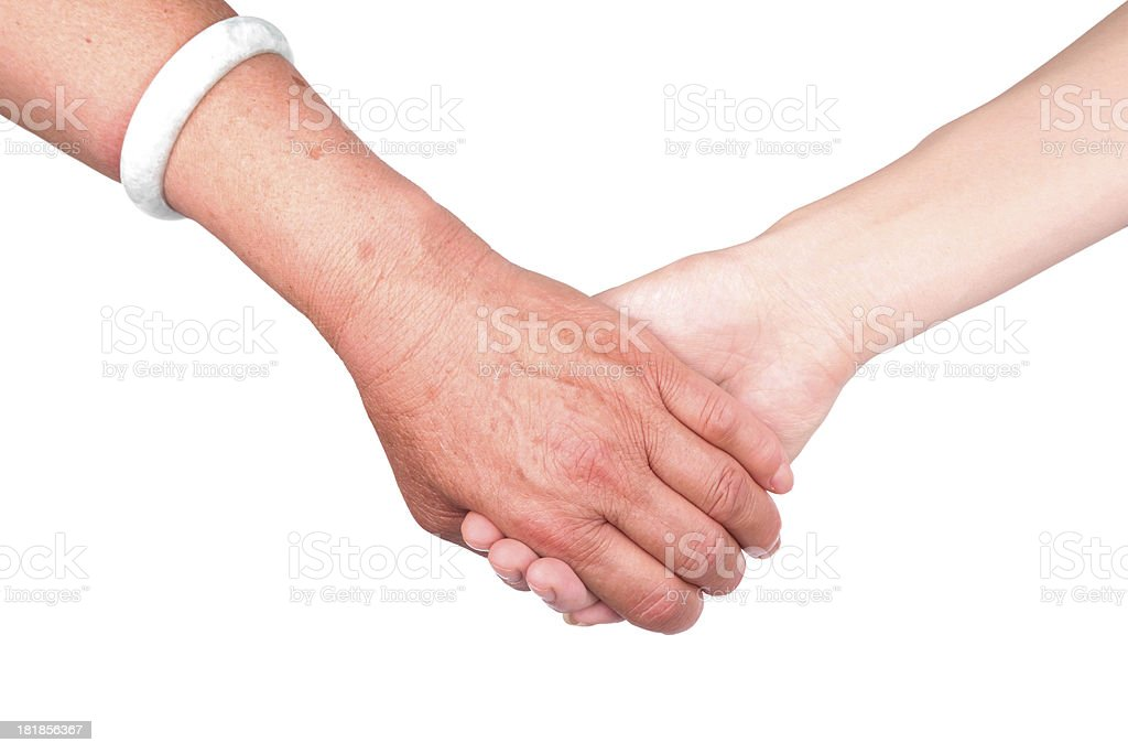 Helping hand:Old and Young Hand isolated on white background royalty-free stock photo