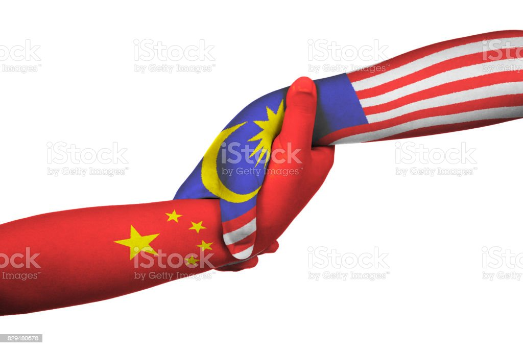 Helping hands of China and Malaysia stock photo