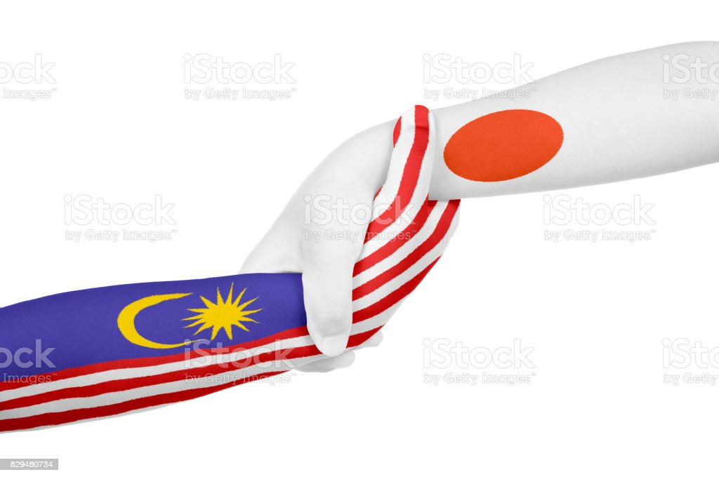 Helping hands of Malaysia and Japan stock photo