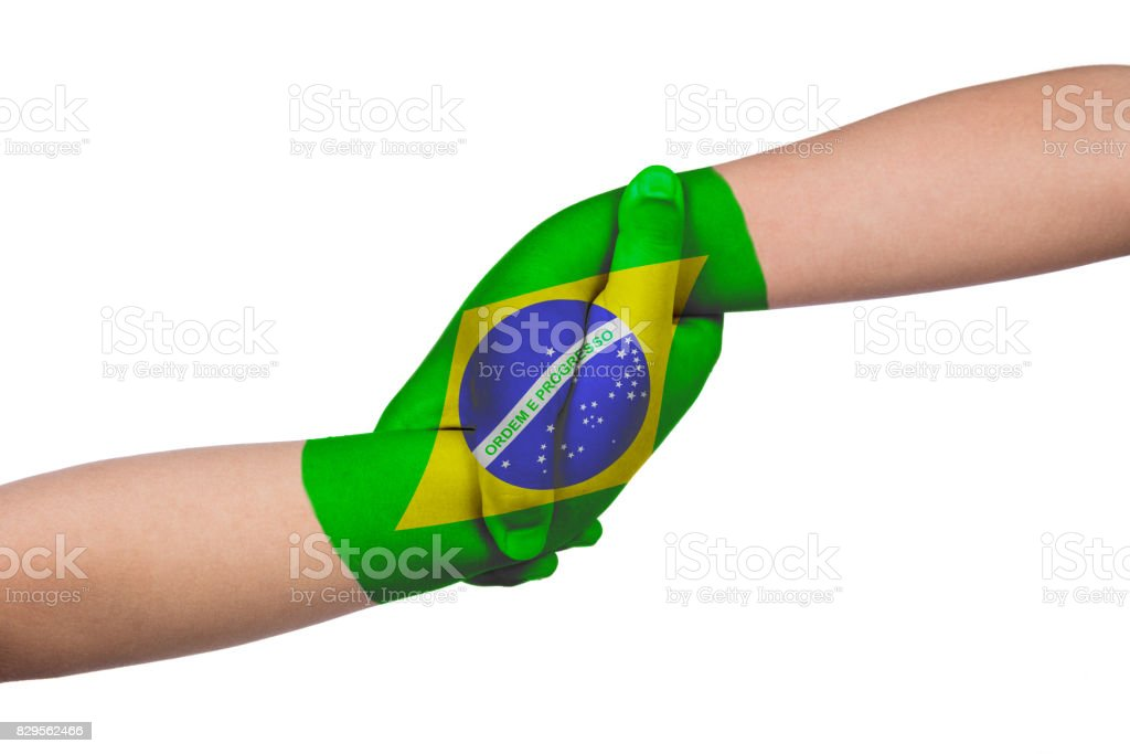Helping hands of two children with Brazil flag painted stock photo