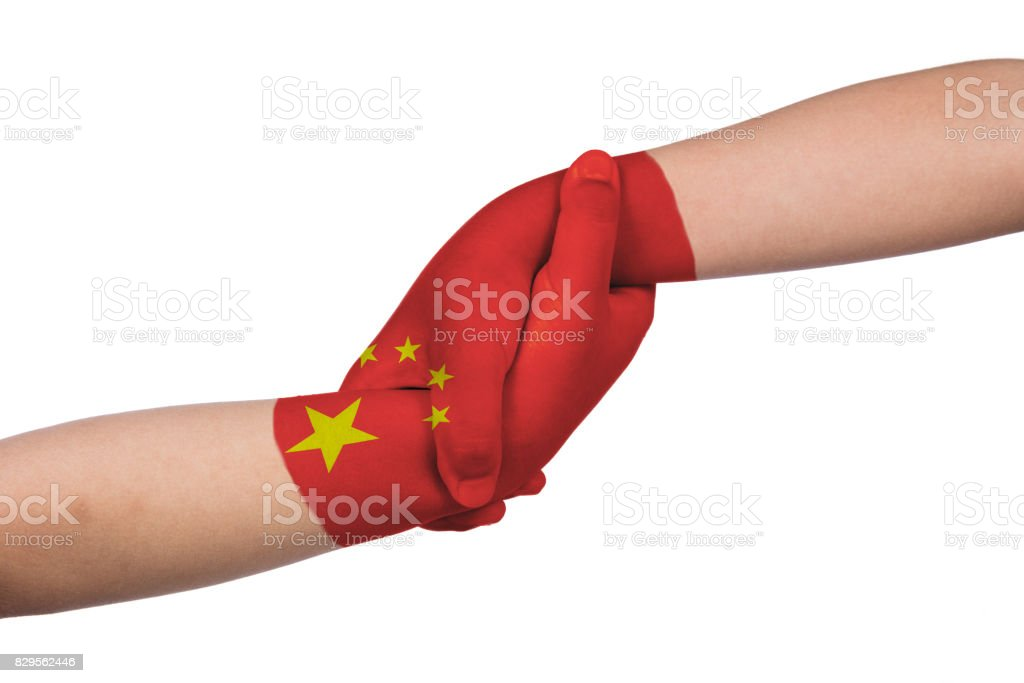 Helping hands of two children with China flag painted stock photo