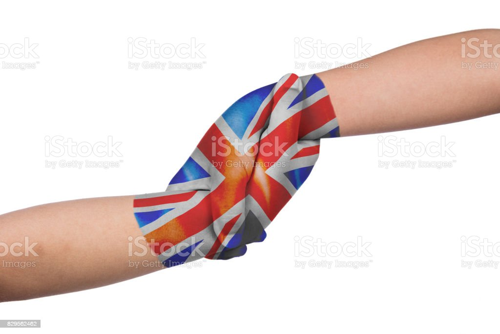 Helping hands of two children with United Kingdom flag painted stock photo