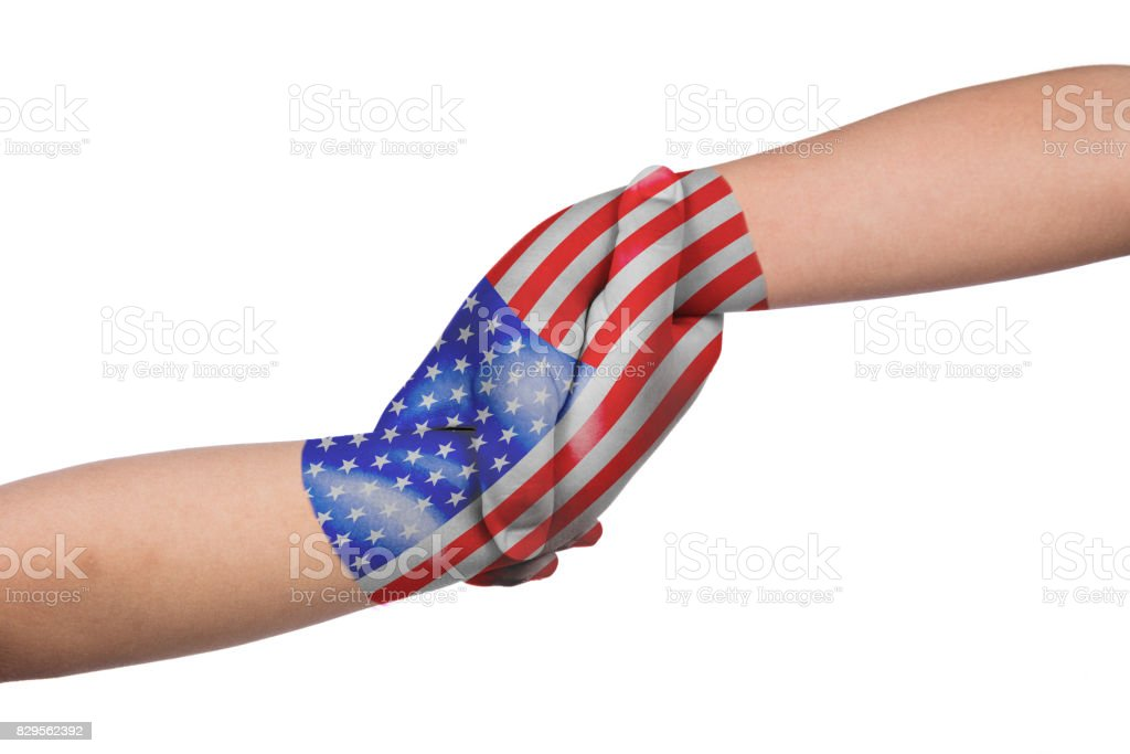 Helping hands of two children with United States of America flag painted stock photo
