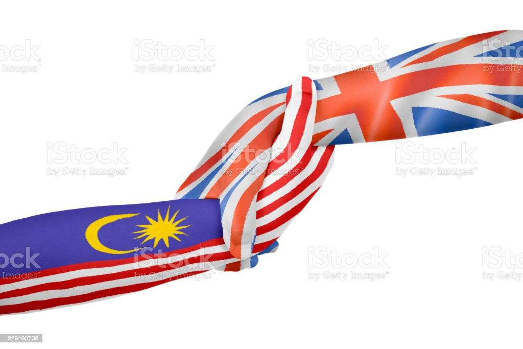 Helping hands of United Kingdom and Malaysia stock photo