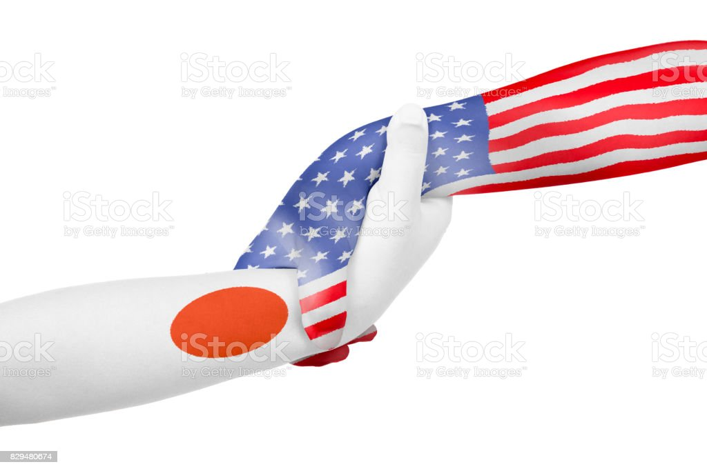 Helping hands of United States of America and Japan stock photo