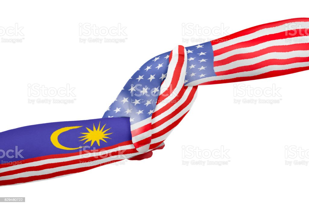 Helping hands of United States of America and Malaysia stock photo
