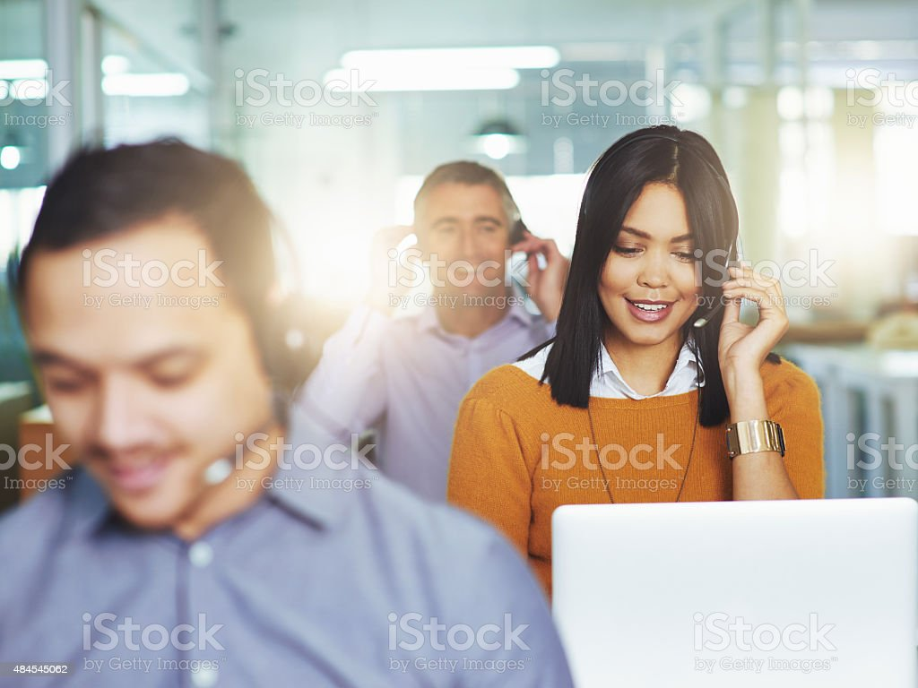 Helping her clients with a smile stock photo