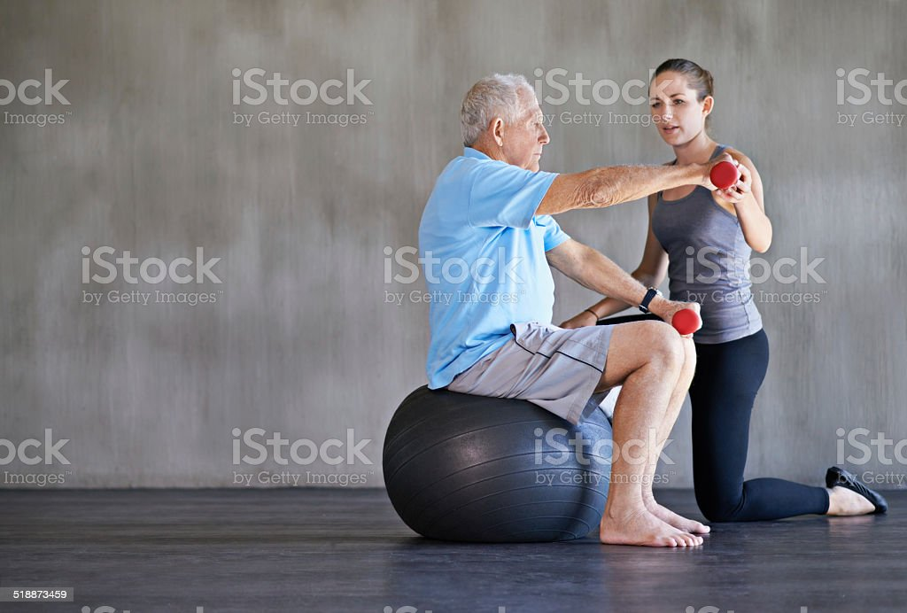 Helping her patients stay strong and healthy stock photo