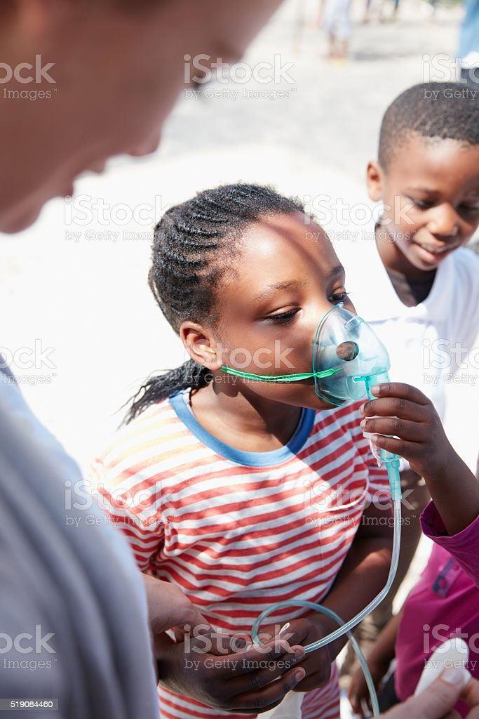 Helping her take better breaths stock photo