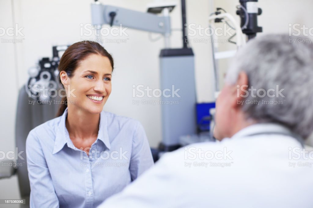 Helping her understand the need for an eye examination stock photo