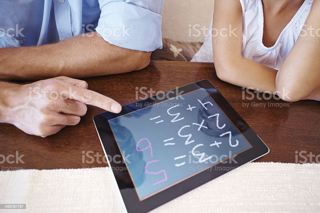 Helping her with homework stock photo