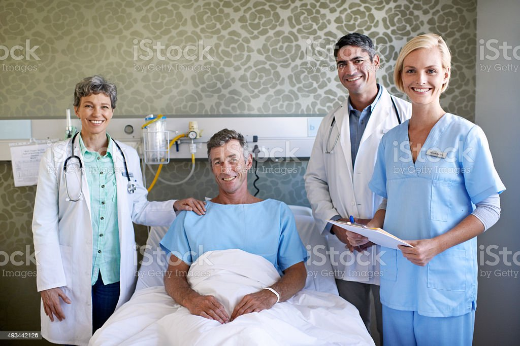 Helping him to a quick recovery stock photo