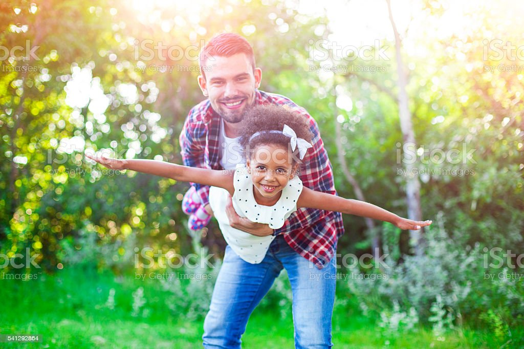 Helping his daughter fly! stock photo