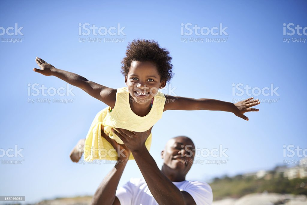 Helping his daughter soar! stock photo