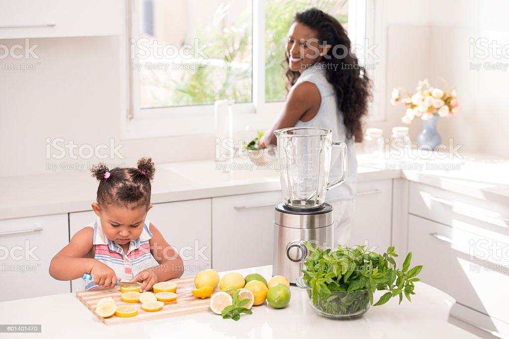 Helping mommy, making fresh lemonade. stock photo