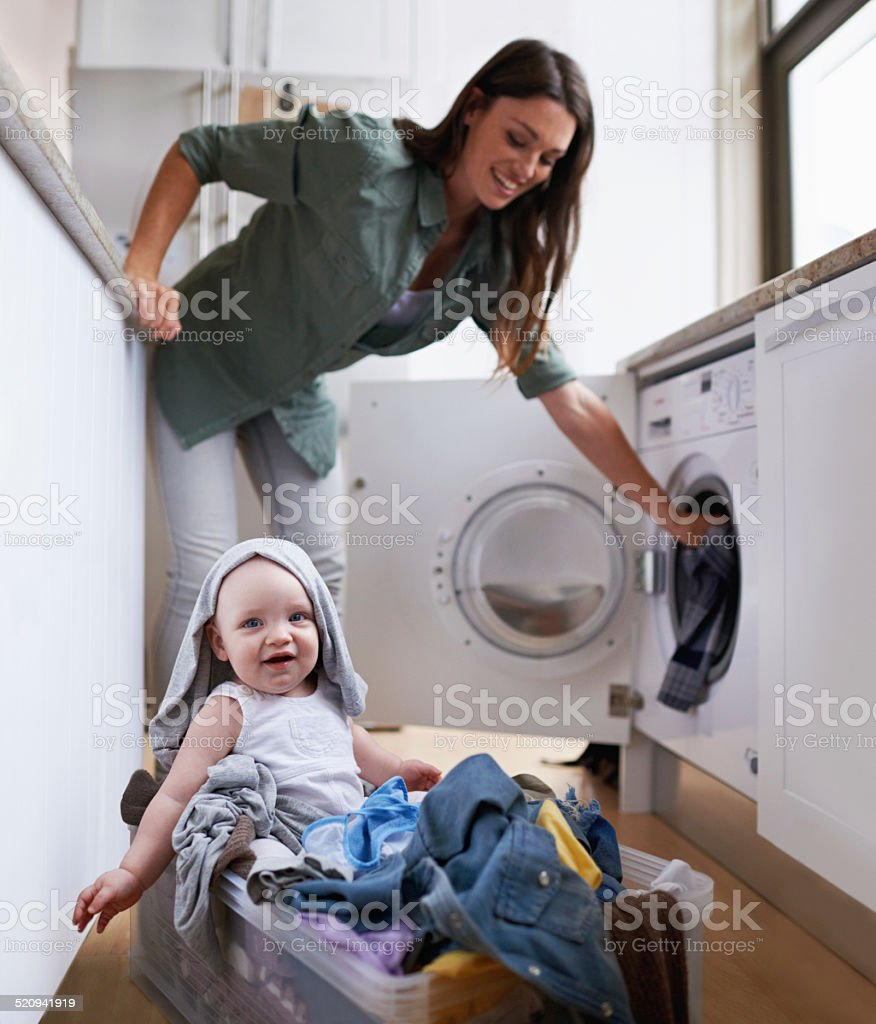 Helping mommy with her chores stock photo
