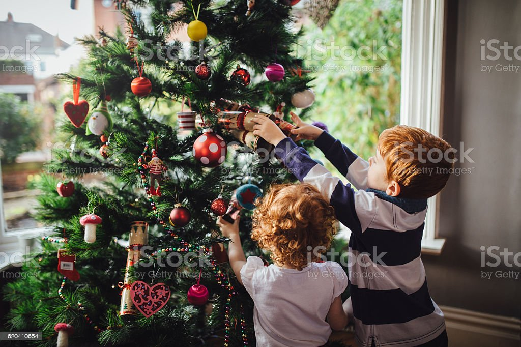 Helping mum with the tree stock photo